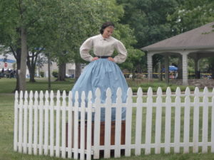 A Lucy Hood reenactor posing with a fence at the Carthage 2011 Civil War reenactment event